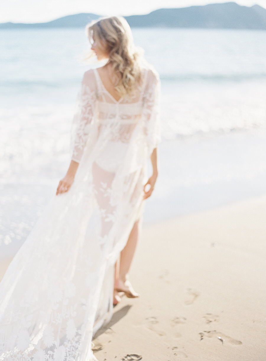 Greece destination wedding or greece honeymoon | A white swim coverup and lace gown | Les Anagnou Photographers