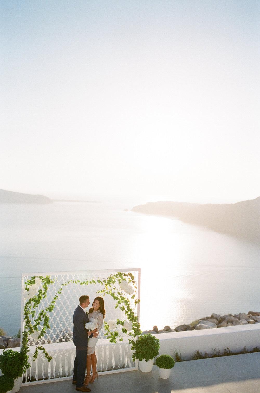 Santorini film wedding photographer Les Ananou | glam intimate santorini elopement