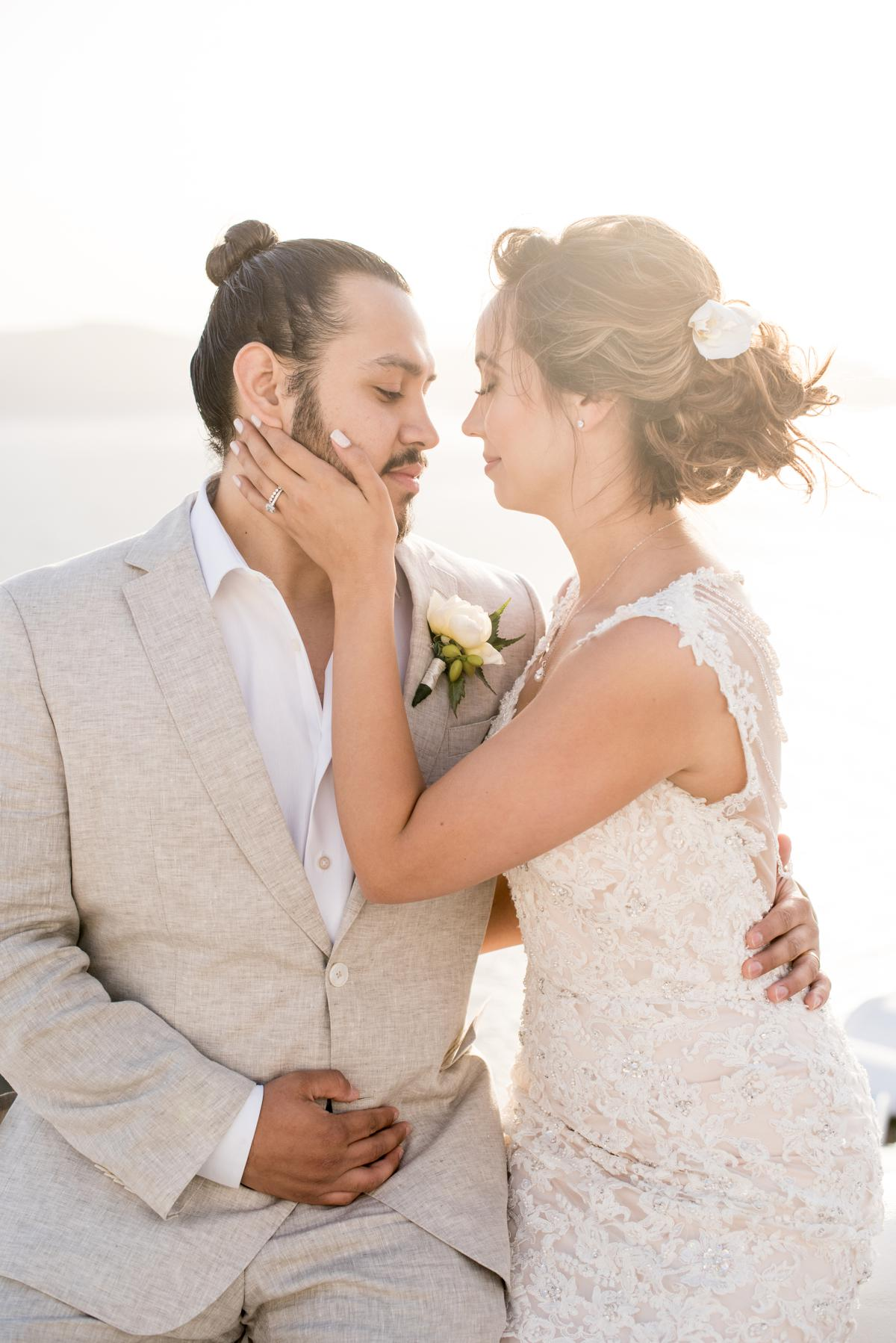 Bride and groom during their portrait session in Santorini