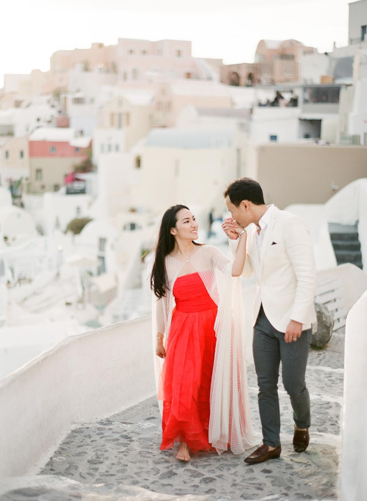hold my hand during engagement session in Santorini