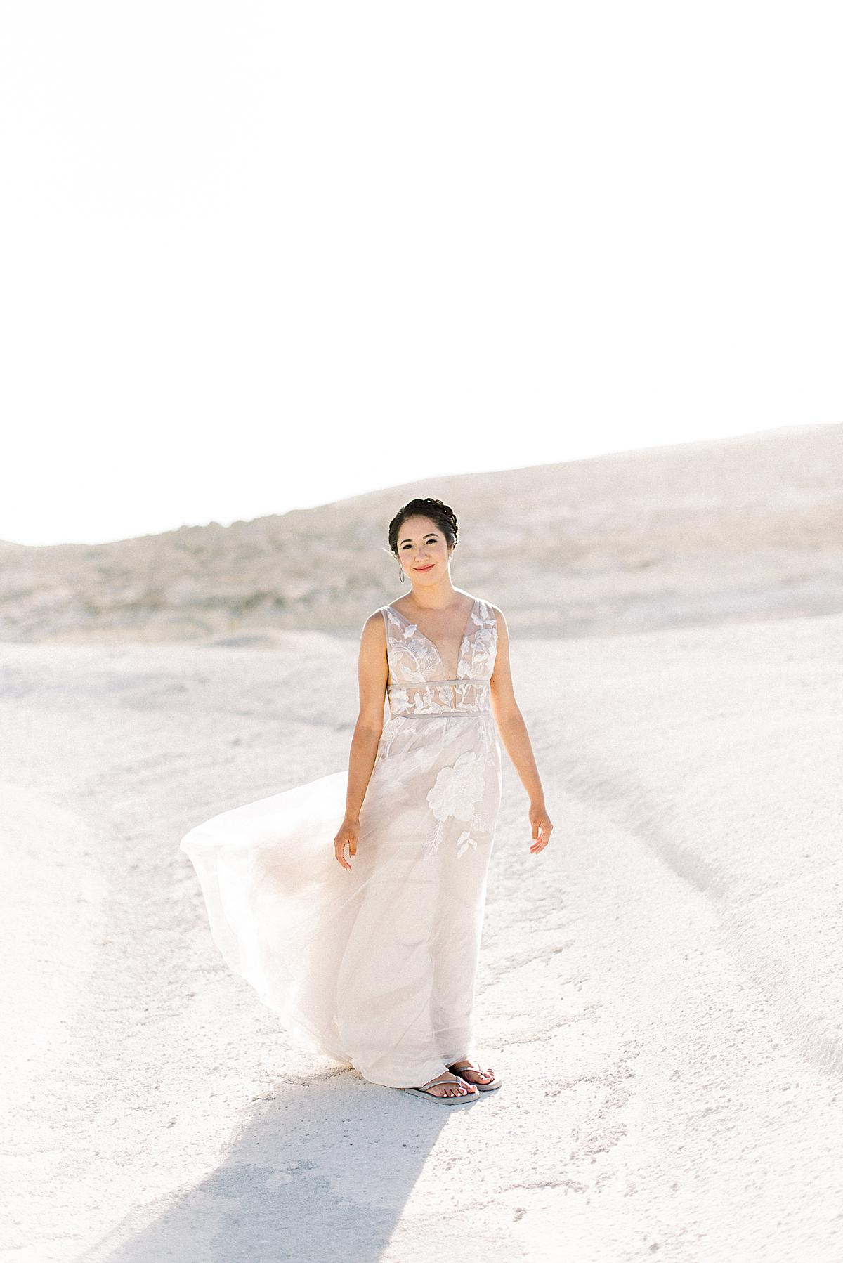Bride during her first look session in Milos island Greece