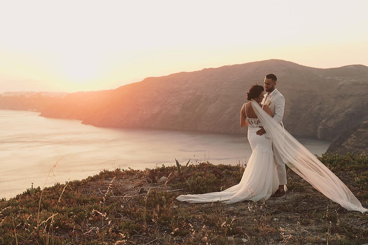 bride and groom at sunset at santorini wedding